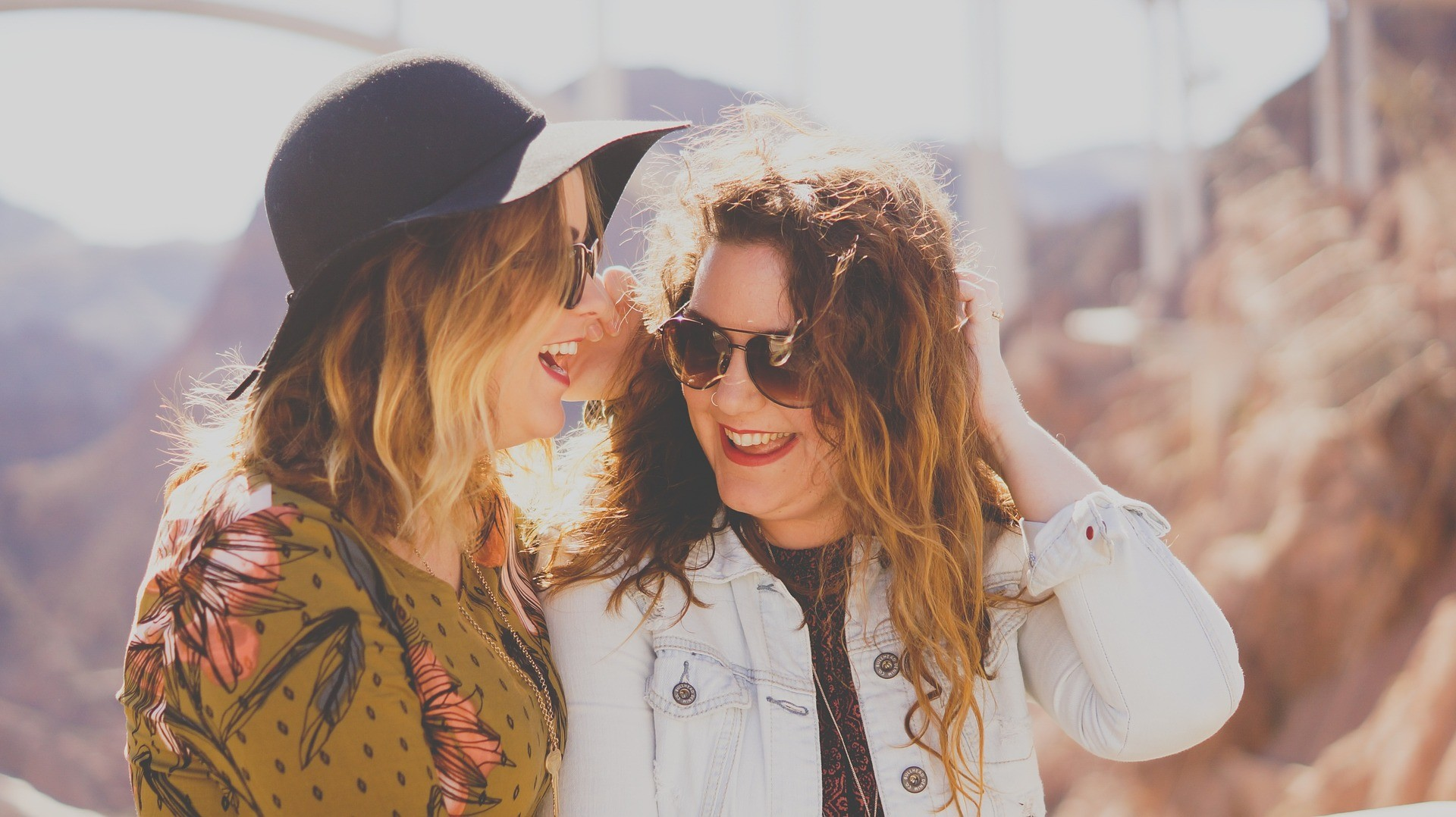 Two women best friends chatting and laughing